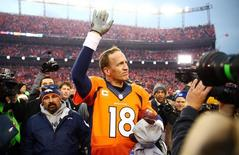 Jan 24, 2016; Denver, CO, USA; Denver Broncos quarterback Peyton Manning (18) waves to the crowd after the AFC Championship football game against the New England Patriots at Sports Authority Field at Mile High. Mandatory Credit: Mark J. Rebilas-USA TODAY Sports