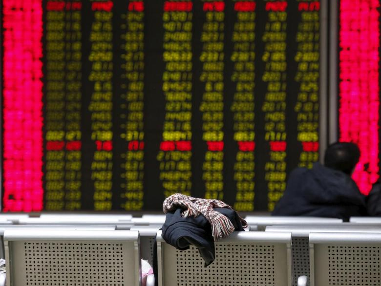 An investor's coat and scarf is placed on a chair in front of an electronic screen showing stock information at a brokerage house in Beijing, China, January 27, 2016.   REUTERS/Kim Kyung-Hoon