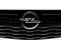 An Opel logo is seen on a car displayed on media day at the Paris Mondial de l'Automobile, October 3, 2014. TREUTERS/Benoit Tessier