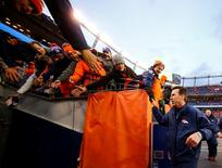 Jan 24, 2016; Denver, CO, USA; Denver Broncos head coach Gary Kubiak greets fans in the stands after defeating the New England Patriots in the AFC Championship football game at Sports Authority Field at Mile High. Mandatory Credit: Kevin Jairaj-USA TODAY Sports