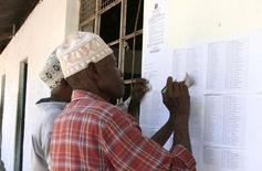 Residents check their names at the electorate list released by the National Electrol Commission of Tanzania (NEC) in Dar es Salaam, in a file photo. REUTERS/Emmanuel Kwitema