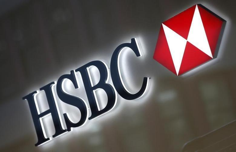 A HSBC logo is seen above the entrance to a HSBC bank branch in midtown Manhattan in New York City, in this December 11, 2012 file photo. REUTERS/Mike Segar