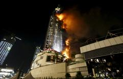 A fire engulfs the Address Hotel in downtown Dubai in the United Arab Emirates in this December 31, 2015 file photo. REUTERS/Ahmed Jadallah/Files