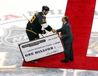 Jan 31, 2016; Nashville, TN, USA; Pacific Division forward John Scott (28) of the Montreal Canadiens shakes hands with NHL Commissioner Gary Bettman after the 2016 NHL All Star Game at Bridgestone Arena. Mandatory Credit: Aaron Doster-USA TODAY Sports