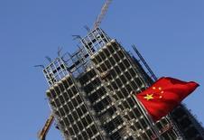 La Chine s'est fixé pour objectif une croissance de 6,5% à 7% cette année mais la réduction des surcapacités devrait se traduire par une augmentation du chômage dans certaines provinces du pays. /Photo d'archives/REUTERS