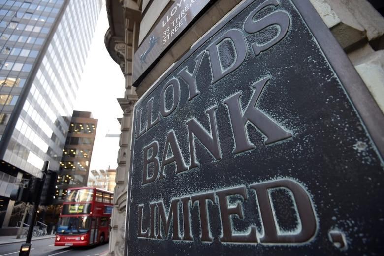 A branch of Lloyds Bank is seen in the City of London December 16, 2014. The Bank of England warned Britain's banks they should expect a more exacting test next year of their defences in the event of a crisis abroad, after state-backed lenders narrowly passed a debut check focused on potential domestic strains. Lloyds and rival Royal Bank of Scotland scraped through this year's test, proving they could withstand the regulator's doomsday scenario of plummeting UK house prices and soaring unemployment, after both took pre-emptive measures to shrink their balance sheets and raise capital. REUTERS/Toby Melville (BRITAIN - Tags: BUSINESS) - RTR4I8R3