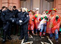 """Police patrol as revellers take part in the traditional """"Weiberfastnacht"""" (Women's Carnival) celebration in Mainz, Germany, February 4, 2016. Germany is celebrating its traditional carnival with tight security after assaults on women during New Year's Eve celebrations across the country. REUTERS/Kai Pfaffenbach"""