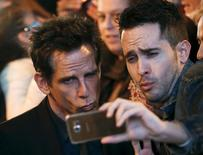"Cast member U.S. actor Ben Stiller (L) poses with a fan during a photo call before the fans screening of his latest film ""Zoolander 2"" in central Madrid, Spain, February 1, 2016. REUTERS/Sergio Perez"