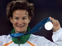 Ireland's Sonia O'Sullivan holds her silver medal for the 5000m final at the Sydney Olympic Games, September 25, 2000.  Reuters photographer