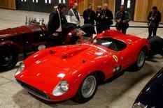 Visitors look at a red 1957 Ferrari 335 Sport Scaglietti model on display at the Paris Retromobile fair in Paris, France, February 5, 2016.  REUTERS/Philippe Wojazer