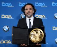 "Alejandro G. Inarritu poses with his Feature Film award for ""The Revenant"" during the 68th annual DGA Awards in Los Angeles February 6, 2016. REUTERS/Phil McCarten"