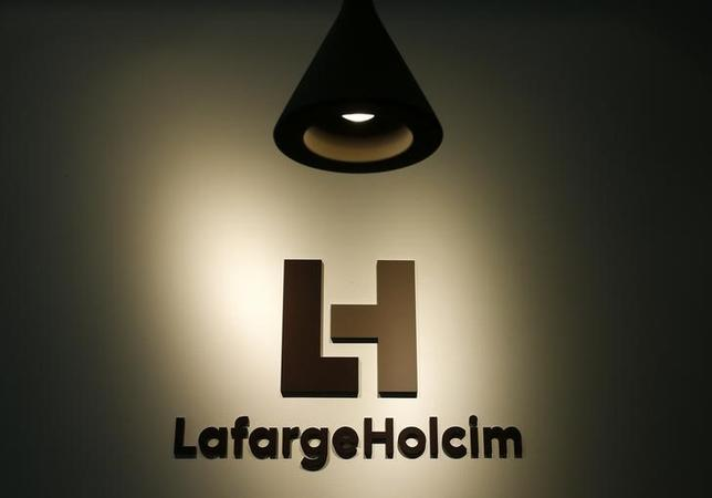 The company's new logo is pictured at the headquarters of LafargeHolcim in Zurich, Switzerland, July 15, 2015.  REUTERS/Arnd Wiegmann/Files