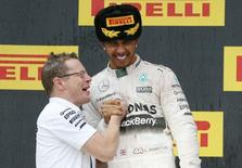 Mercedes Formula One driver Lewis Hamilton of Britain (R) celebrates winning the Russian F1 Grand Prix with Andy Cowell, managing director of Mercedes AMG High Performance Powertrains in Sochi, Russia, October 11, 2015.  REUTERS/Grigory Dukor