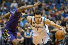 Feb 8, 2016; Minneapolis, MN, USA; Minnesota Timberwolves guard Tyus Jones (1) dribbles the ball past New Orleans Pelicans guard Toney Douglas (16) in the second half at Target Center. Mandatory Credit: Jesse Johnson-USA TODAY Sports