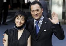 Actor Ken Watanabe (R) and his wife Kaho Minami arrive for the world premiere of the film ''Inception'' at the Odeon in London in this July 8, 2010 file photo.  REUTERS/Stefan Wermuth/Files