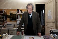 "Jean-Jacques Fernier, Gustave Courbet Institute art expert, stands at his desk near photocopies of his own document which shows the ""L'Origine du Monde, 1866""  (The Origin of the World) as he speaks to the media in his office in Paris February 7, 2013.  REUTERS/Jacky Naegelen"