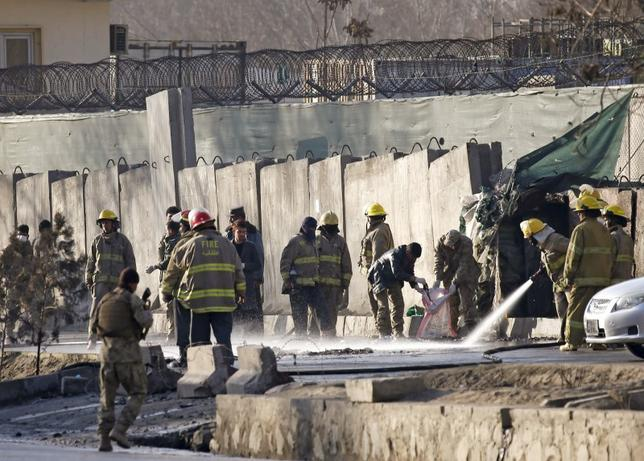 Afghan fire-fighters and members of security forces clean the site of a suicide attack in Kabul, Afghanistan February 1, 2016.   REUTERS/Omar Sobhani