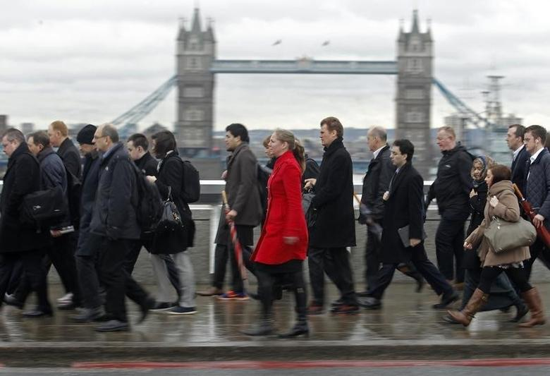 Rush hour workers pass Tower Bridge in the financial district of the City of London January 29, 2013.   REUTERS/Luke Macgregor