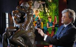 """Auctioneer Alexandre Giquello looks at the sculpture """"Le Baiser"""" (the Kiss), bronze cast made in 1927, which is part of an exceptional sale of five remarkable bronzes by the French sculptor Auguste Rodin (1840-1917), displayed in Paris, France, February 11, 2016. REUTERS/Philippe Wojazer"""