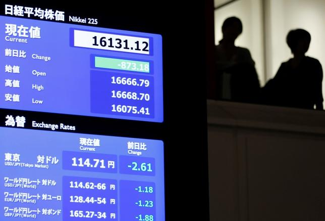 Visitors stand next to an electronic board showing the Japan's Nikkei average (top) and the Japanese yen's exchange rate against the U.S. dollar at the Tokyo Stock Exchange (TSE) in Tokyo, Japan, February 9, 2016. REUTERS/Issei Kato