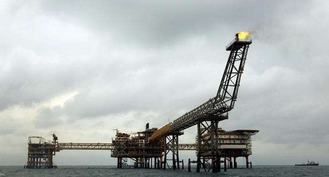The SPQ1 gas platform is seen on the southern edge of Iran's South Pars gas field in the Gulf, off Assalouyeh, 1,000 km (621 miles) south of Tehran, in this January 26, 2011 file photo. REUTERS/Caren Firouz