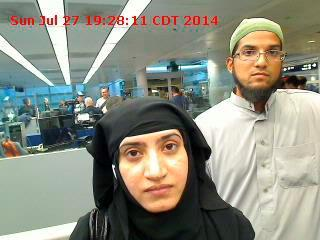 Tashfeen Malik and Syed Farook are pictured passing through Chicago's O'Hare International Airport in July 2014. REUTERS/US Customs and Border Protection