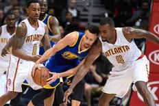 Feb 22, 2016; Atlanta, GA, USA; Golden State Warriors guard Stephen Curry (30) is defended by Atlanta Hawks forward Paul Millsap (4) during the second half at Philips Arena. The Warriors defeated the Hawks 102-92. Mandatory Credit: Dale Zanine-USA TODAY Sports