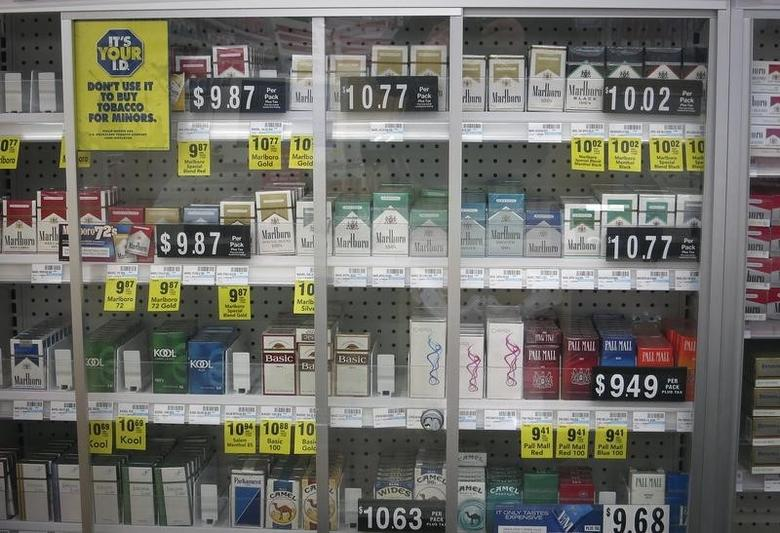 Shelves full of cigarettes are pictured at a CVS store in the Manhattan borough of New York February 5, 2014.  REUTERS/Carlo Allegri
