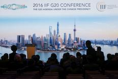 Pepole attend the 2016 IIF G20 Conference at the financial district of Pudong in Shanghai, China, February 25, 2016. REUTERS/Aly Song