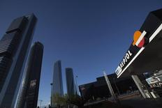 A Repsol petrol station is seen in front of the Repsol office building in Madrid April 16, 2012. Argentine President Cristina Fernandez unveiled plans on Monday to seize control of leading energy company YPF, drawing swift warnings from key trade partners and risking the country's further economic isolation. YPF, which is controlled by Spain's Repsol, has been under intense pressure from Fernandez's center-left government in recent months and its share price has plunged due to months of speculation about a state takeover. REUTERS/Juan Medina (SPAIN - Tags: POLITICS ENERGY BUSINESS) - RTR30TLN