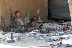 """Fighters from a coalition of rebel groups called """"Jaish al Fateh"""", also known as """"Army of Fatah"""" (Conquest Army), rest after clashes with forces loyal to President Bashar al-Assad in al-Ghab plain in the province of Hama, Syria August 6, 2015. REUTERS/Ammar Abdullah - RTS7WVE"""