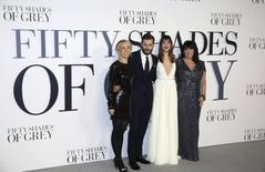 (L-R) Director of the film Sam Taylor-Johnson, cast members Jamie Dornan, Dakota Johnson and author E. L. James arrive for the British premiere of the movie 'Fifty Shades of Grey' in London in this February 12, 2015 file photo. REUTERS/Paul Hackett/Files