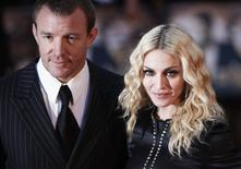 """Director Guy Ritchie and wife Madonna arrive for the world premiere of """"RocknRolla"""" in London, in this file photo taken September 1, 2008.   REUTERS/Stephen Hird/Files"""