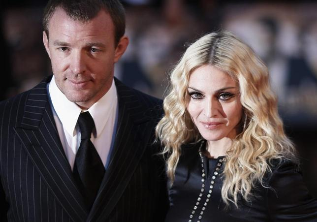 Director Guy Ritchie and wife Madonna arrive for the world premiere of ''RocknRolla'' in London, in this file photo taken September 1, 2008.   REUTERS/Stephen Hird/Files
