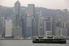 A ferry sails at Victoria Harbour in front of the financial Central district, featuring AIA Central (C) and Cheung Kong Center behind it, in Hong Kong, China February 17, 2016.   REUTERS/Bobby Yip