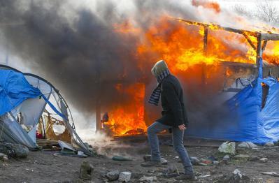 Migrant jungle in flames