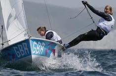 Britain's Saskia Clark and Hannah Mills sail during the first race of the women's 470 sailing class at the London 2012 Olympic Games in Weymouth and Portland, southern England, August 3, 2012. REUTERS/Pascal Lauener