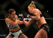 March 5, 2016; Las Vegas, NV, USA; Holly Holm moves in with a punch against Miesha Tate during UFC 196 at MGM Grand Garden Arena. Mandatory Credit: Mark J. Rebilas-USA TODAY Sports