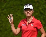 Aug 23, 2015; Coquitlam, British Columbia, CAN; Lydia Ko drives from the first tee during the fourth round at Vancouver Golf Club. Mandatory Credit: Anne-Marie Sorvin-USA TODAY Sports
