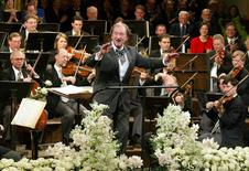 Maestro Nikolaus Harnoncourt conducts the traditionel New Year's Concert of the Vienna Philharmonics in Vienna, Austria, in this January 1, 2003 file photo.    REUTERS/Leonhard Foeger/Files