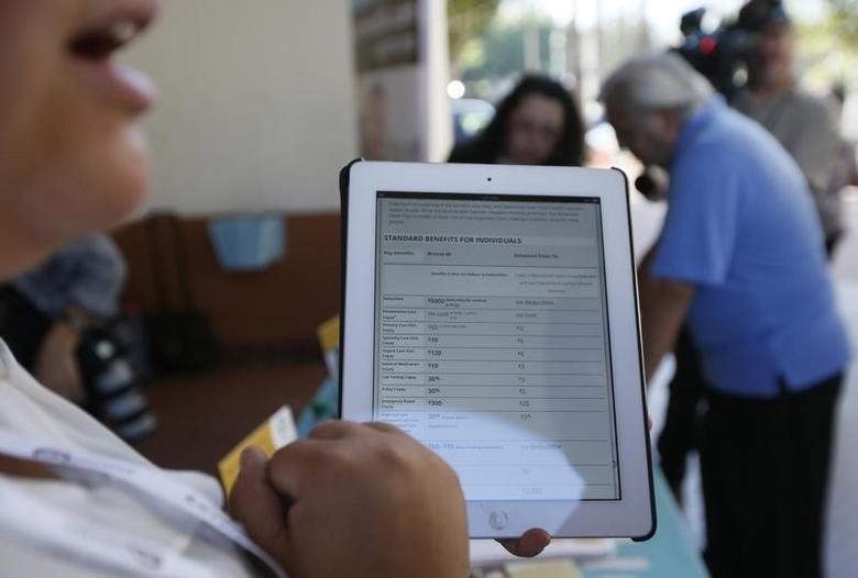 A woman explains healthcare benefits at a Covered California event which marks the opening of the state's Affordable Healthcare Act, commonly known as Obamacare, health insurance marketplace in Los Angeles, California, October 1, 2013. REUTERS/Lucy Nicholson