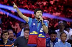 Filipino boxer Manny Pacquiao, who is running for Senator in the May 2016 national elections, speaks to supporters during the start of elections campaigning in Mandaluyong city, Metro Manila February 9, 2016.     REUTERS/Janis Alano