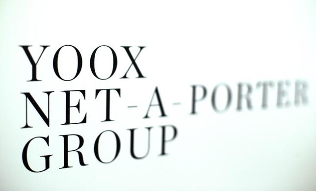Yoox Net-A-Porter Group placard is seen in Bologna, Italy, March 1, 2016. REUTERS/Stefano Rellandini