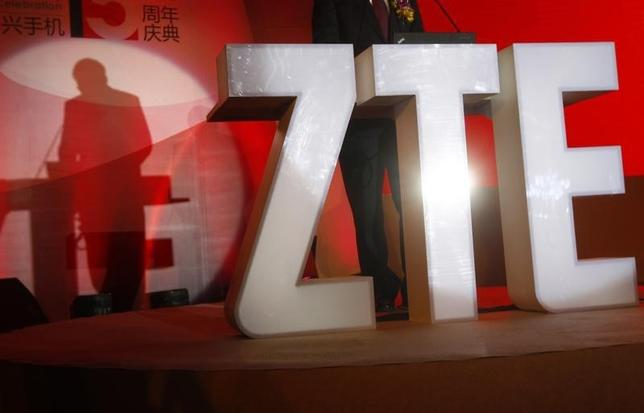 The ZTE company logo is seen as a guest delivers a speech during the company's 15th anniversary celebration in Beijing April 18, 2013.   REUTERS/Barry Huang