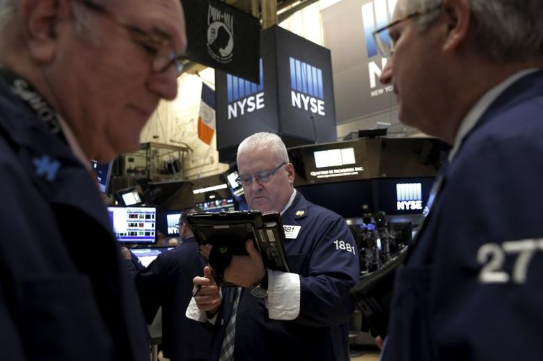 Traders work on the floor of the New York Stock Exchange (NYSE) March 4, 2016. REUTERS/Brendan McDermid