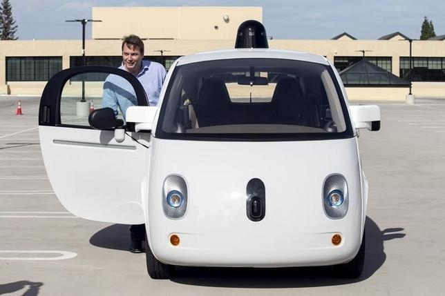 Chris Urmson, Director of the Self Driving Cars Project at Google, gets out of a prototype self-driving car during a media preview of Google's prototype autonomous vehicles in Moutain View, California September 29, 2015.  REUTERS/Elijah Nouvelage