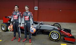 Haas Formula One drivers Esteban Gutierrez of Mexico (L) and Romain Grosjean of France smiles as they pose next to new VF-16 F1 car before the first testing session ahead of the upcoming season at the Circuit Catalunya-Barcelona in Montmelo, Spain, February 22, 2016. REUTERS/Sergio Perez