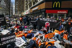 Protesters participate in a 'die in in front of a McDonald's restaurant during demonstrations asking for higher wages in New York, in this file photo taken April 15, 2015. REUTERS/Lucas Jackson/Files
