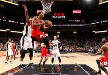 Chicago Bulls point guard Derrick Rose (1) shoots the ball past San Antonio Spurs power forward Tim Duncan (21, left) during the second half at AT&T Center. The Spurs won 109-101. Mandatory Credit: Soobum Im-USA TODAY Sports