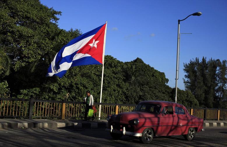 A Cuban flag flies over 'Almendares' bridge in Havana, Cuba February 26, 2016. REUTERS/Enrique de la Osa